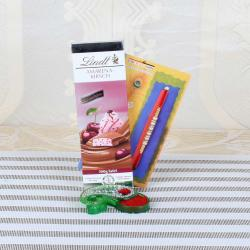 Lindt Amarena Kirsch Chocolate with Pearl Diamond Beads Rakhi Combo