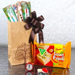 3 Designer Rakhis with Laxmi Ganesh Coin and  Soan Papdi