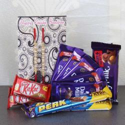 Assorted Cadbury Chocolate and Set of Two Rakhi.