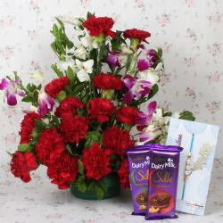 Assorted Flowers Arrangement with Chocolate and Rakhi