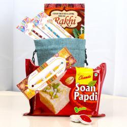 Beautiful Five Rakhis with Soan Papdi
