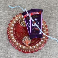 Designer Thali with Cadbury Dairy Milk Chocolate and Rudraksha Rakhi