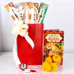 Exclusive Rakhis and Kesar Peda with Laxmi Coin