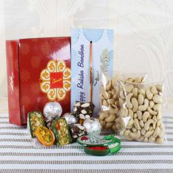 Exotic Assorted Sweets with Dry Fruits and Rakhi
