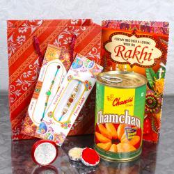 Gift Bag of 2 Rakhi and Chamcham with Laxmi Coin and Rakhi Card
