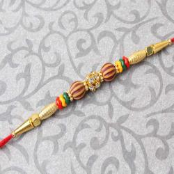 Golden Design with Diamond Studded Rakhi