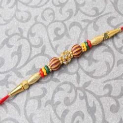 Golden Design with Diamond Studded Rakhi