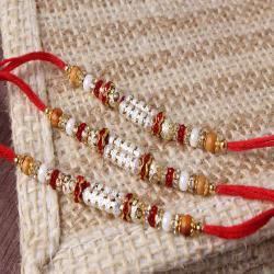Marvellous Shiny Triple Rakhi Set Online