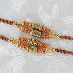 Pair of Two Diamond Rings and Golden Strings Rakhi