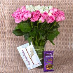 Pink and White Roses arrangement with Chocolate and Rakhi