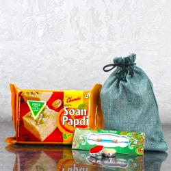 Rakhi Gift Potli of Soan Papdi and Kumkum Chawal