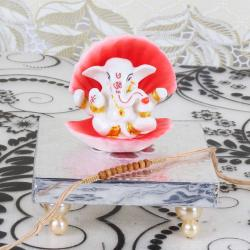 Shell Covered Ganesha Idol on Designer Chowki with Rakhi