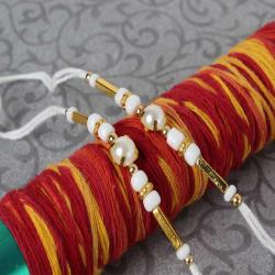 Superb Pair of Two Simple Pearl Beads Rakhi