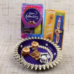 Swastika Puja Thali with Mini Celebration Chocolate and Rakhi