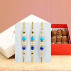 Three Designer Rakhi with 500 Gms Besan Ladoo